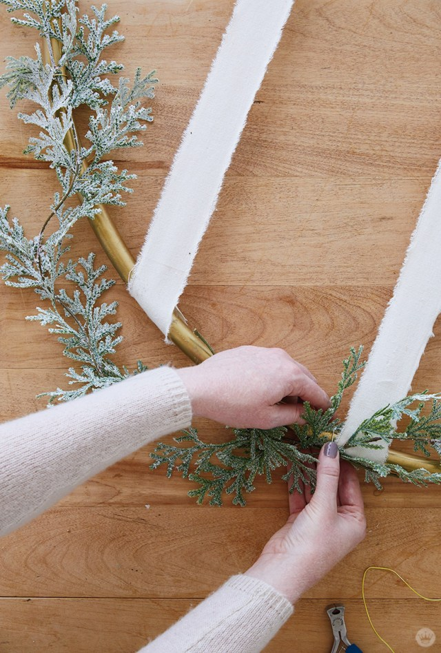 Attaching greenery to Gold Hoop Christmas Card Display
