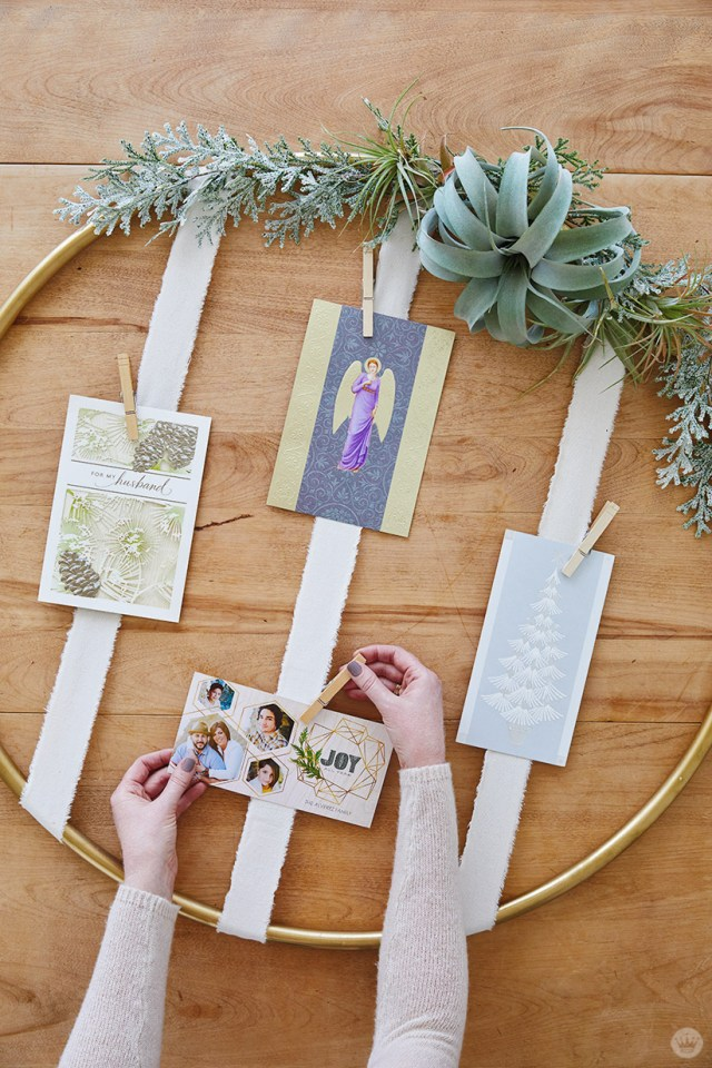 Attaching Christmas cards to Gold Hoop Christmas Card Display