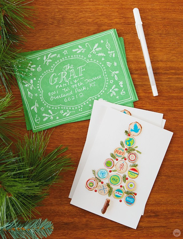 Christmas card envelopes decorated and ready to send