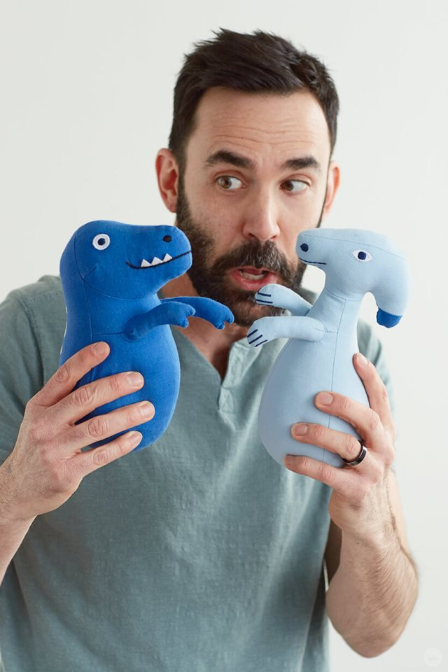 Colin W. plays with the Dinos Weighted Plush Set from the Dinos & Botanicals collection from Hallmark Baby
