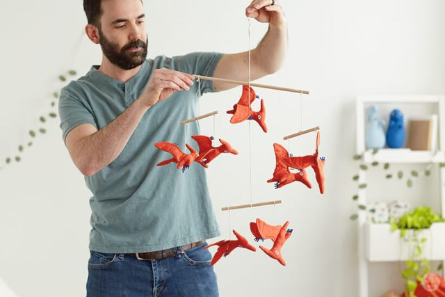 Colin W. plays with the Flying Dinosaurs Nursery Mobile from the Dinos & Botanicals collection from Hallmark Baby