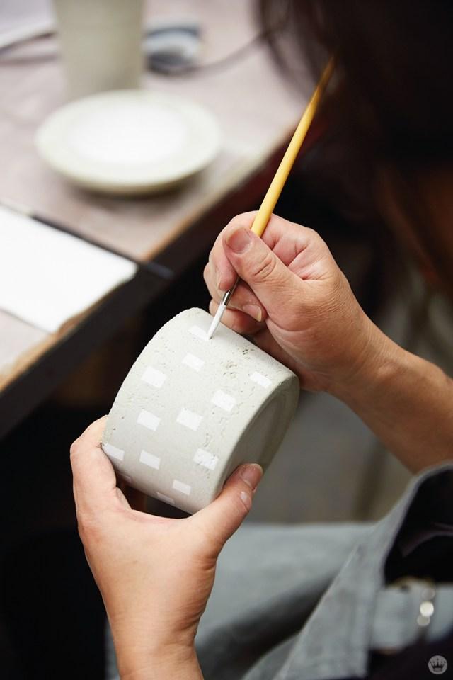 Painting a DIY concrete vase