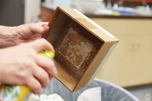 Spraying the inside of a cardboard box mold