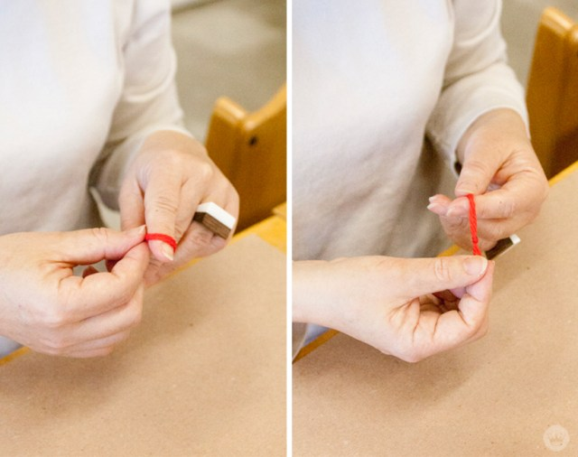 Adding string to your DIY Christmas paper ornaments.