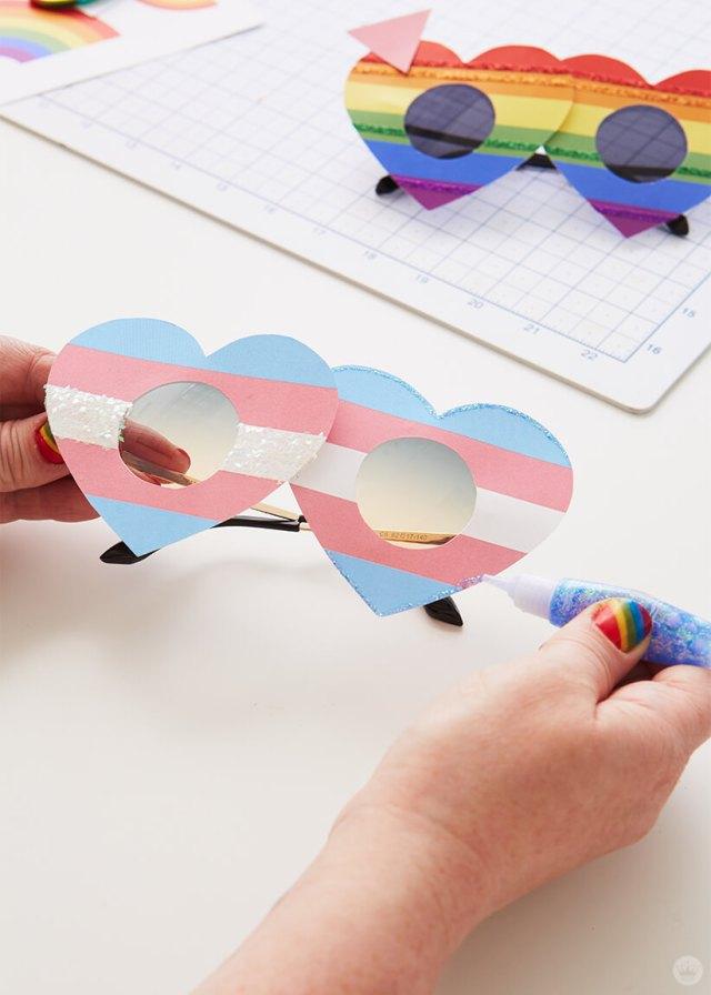 Adding glitter to the DIY Pride Sunglasses | thinkmakeshareblog.com