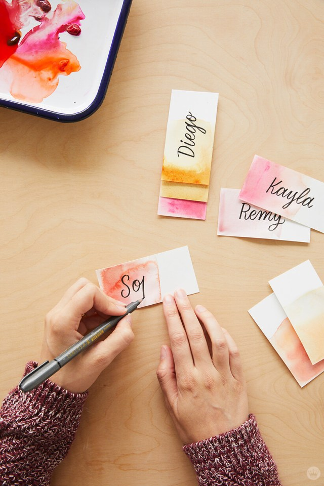 Lettering names on dip-dye Friendsgiving place cards | thinkmakeshareblog.com