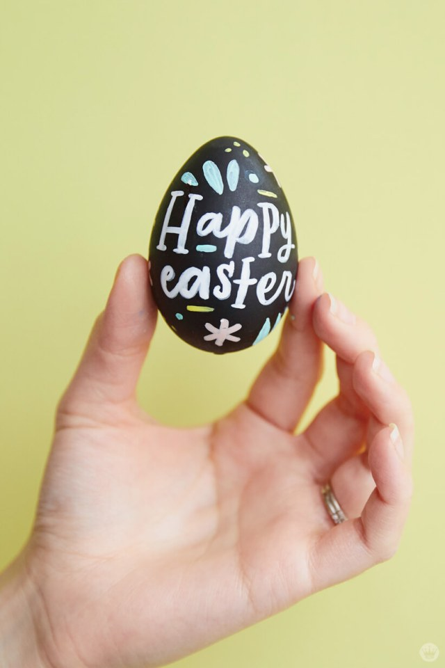 Holding a decorated Easter egg