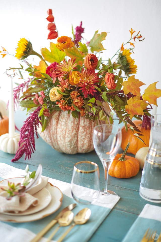 Pumpkin used as vase for flower arrangement