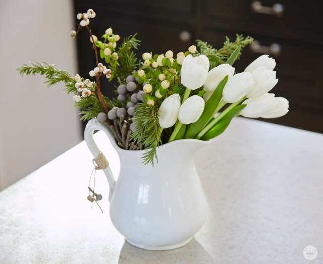 Easy Easy holiday gift giving tips from a Hallmark stylist. White holiday florals in simple white vase.