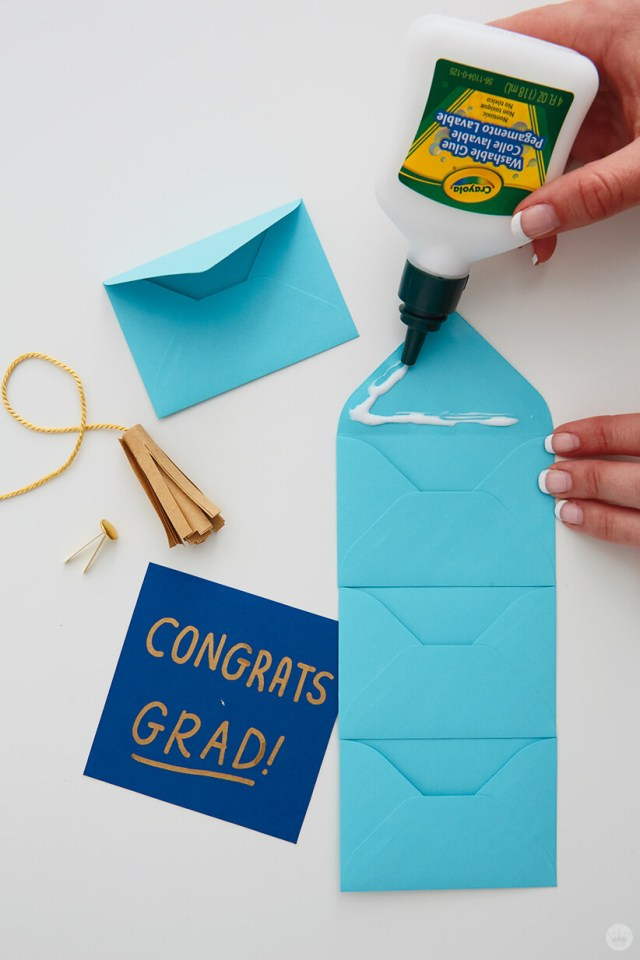 Glueing the just because mini envelopes together for the Mini Graduation Gift | thinkmakeshareblog.com