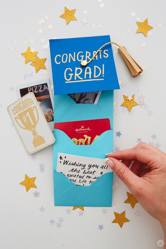 placing a small well wishes card into an envelope for the Mini Graduation Gift | thinkmakeshareblog.com