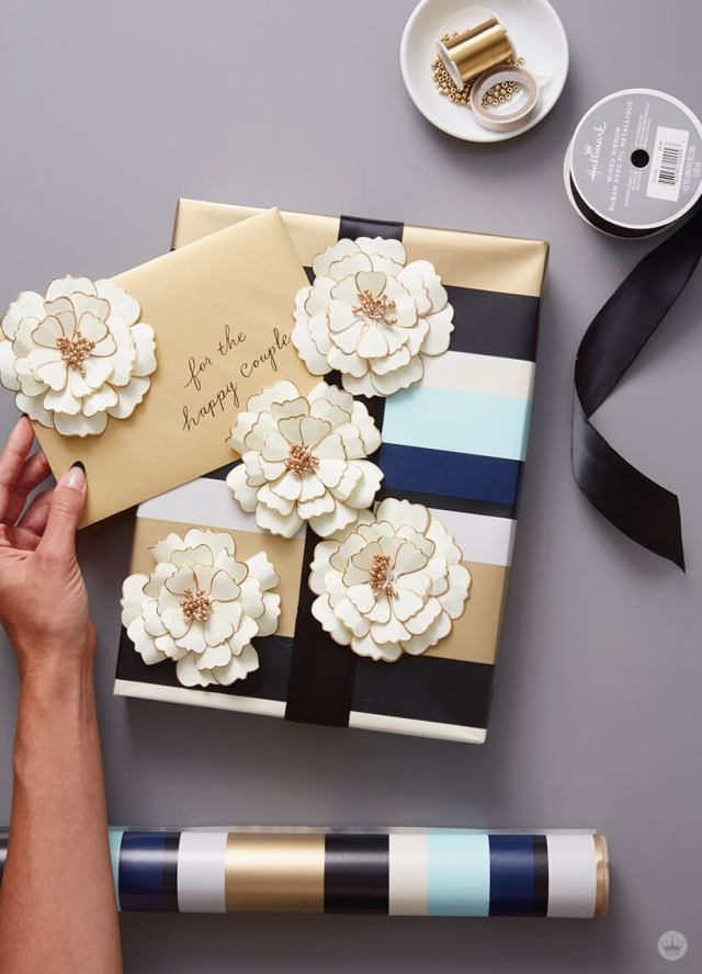 Wrap a wedding present with multiple paper flowers as design element   thinkmakeshareblog.com