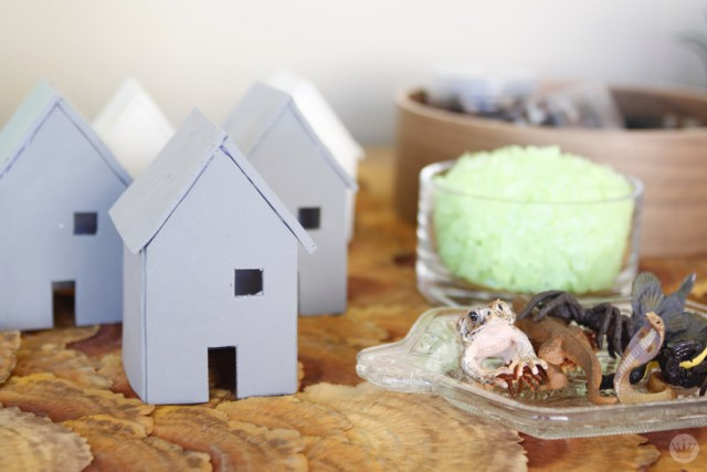 Supplies for Miniature Haunted Houses: Simple clay house templates made of Crayola Model Magic, assorted plastic creepy crawly things, shiny stones, and moss.