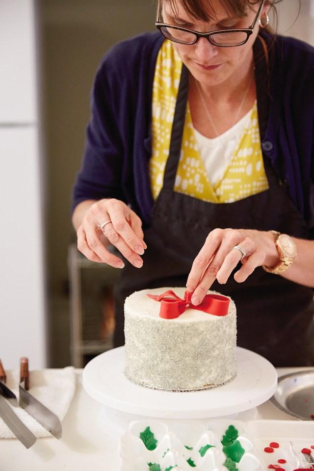 Adding a fondant bow to a layer cake