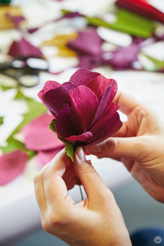 Making DIY crepe paper flowers for holiday decorations