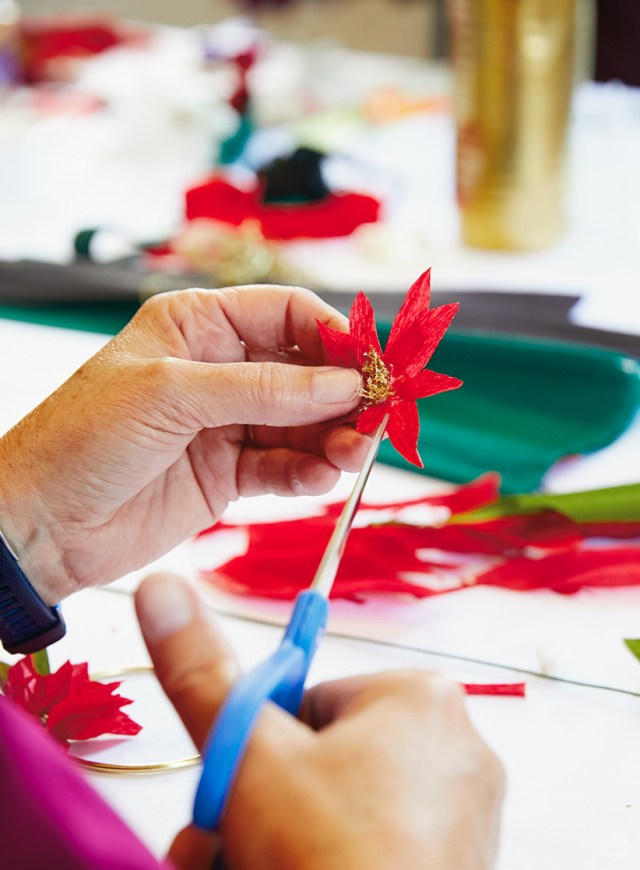 Snipping a DIY paper poinsettia into shape