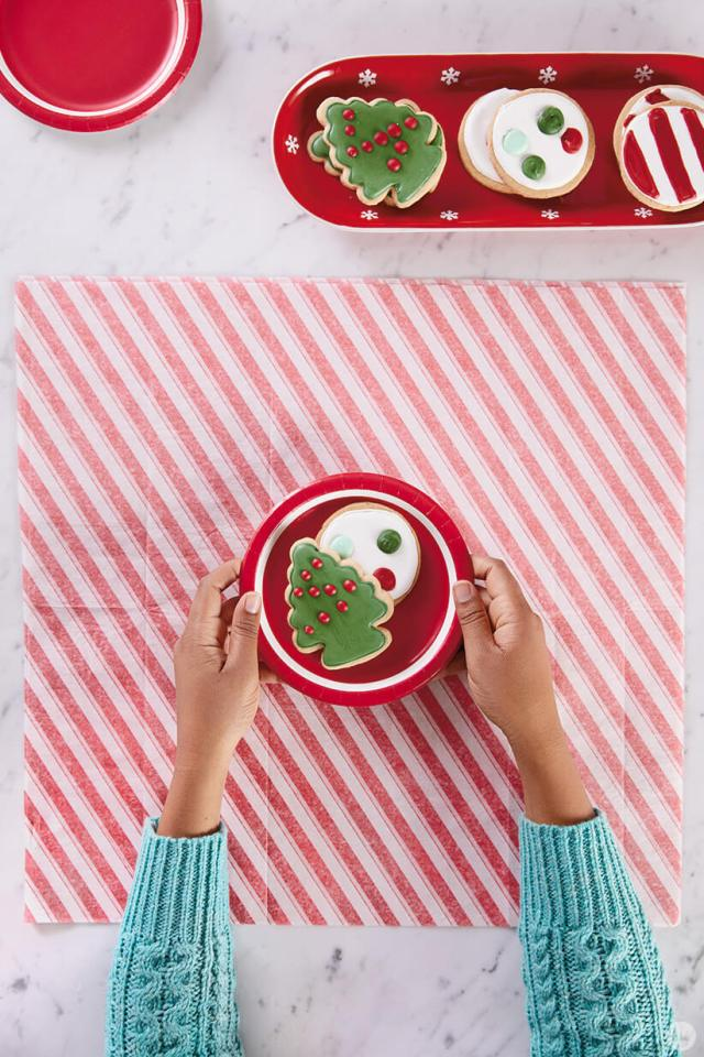 Iced sugar cookies on a paper plate | thinkmakeshareblog.com