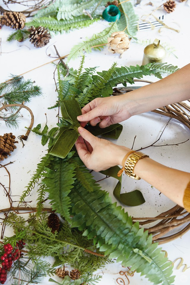 Modern Christmas wreath ideas: Adding ferns and ribbon to a grapevine wreath