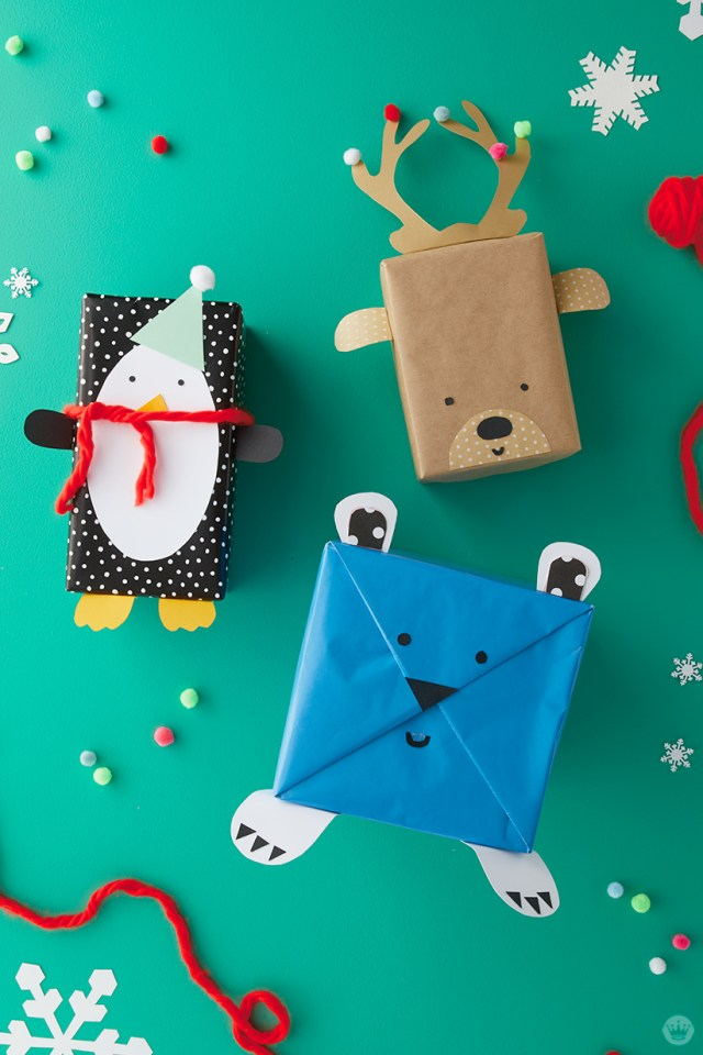 Kids Holiday Gift wrap Ideas: Presents wrapped as penguin, reindeer, and polar bear