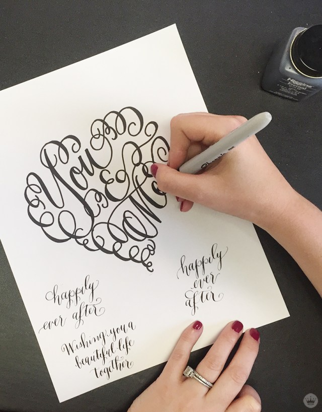"A Laura Hooper Calligraphy design: a heart featuring the words ""You & Me."""
