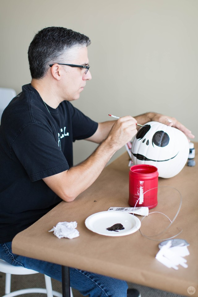 Painting a pumpkin to look like Jack Skellington from The Nightmare Before Christmas