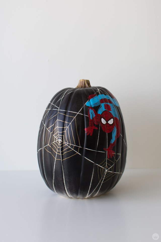 Marvel Comics character Spider-Man painted on a black pumpkin with painted web designs