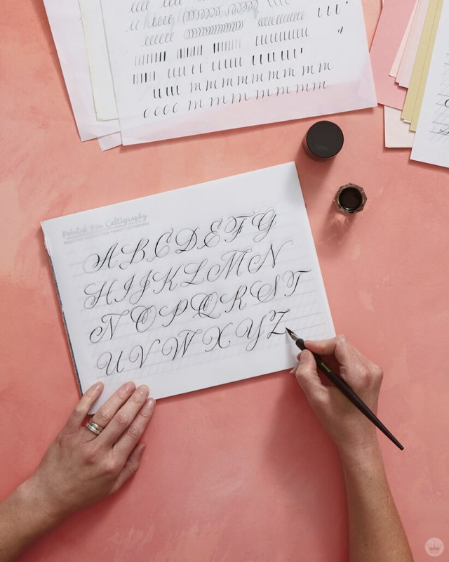Tracing upper-case letters to practice pointed pen calligraphy