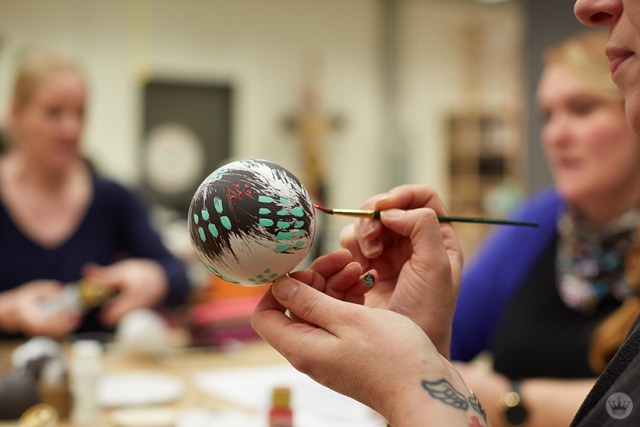 DIY ornament ideas: Hand painting a Christmas ornament.