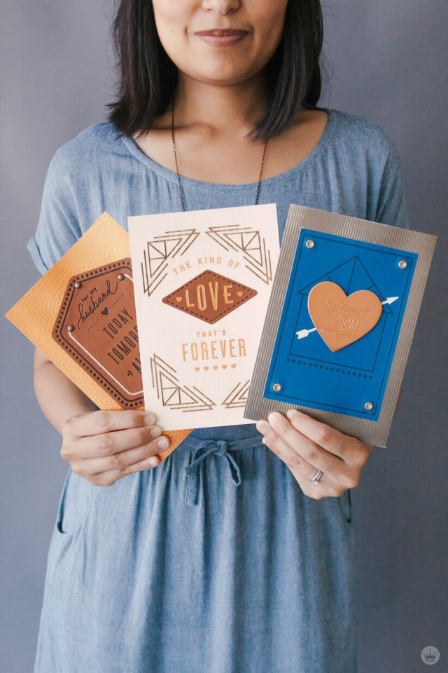 Hallmark Designer Riga S. holds several Man Made Father's Day cards from her collection