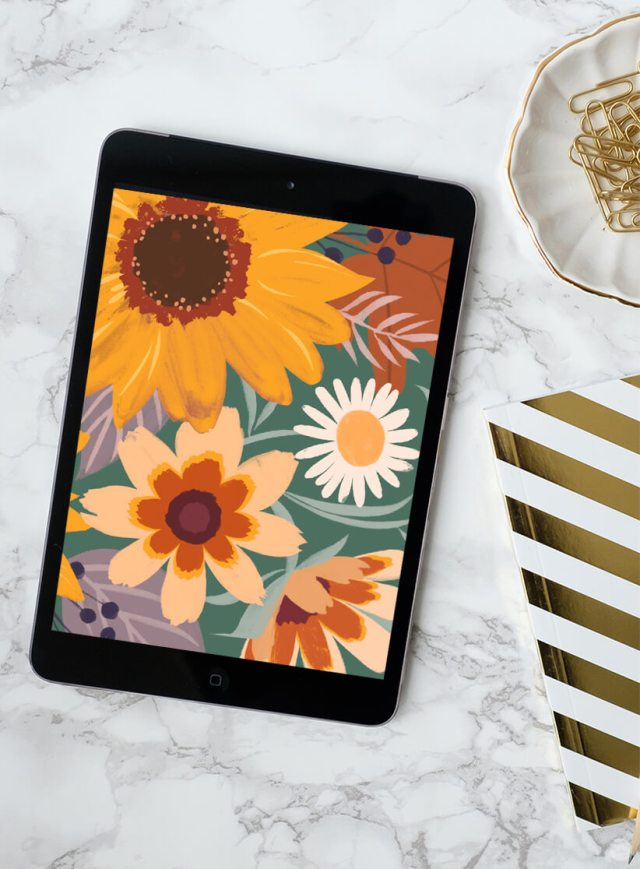 Fall flowers from our FREE November 2019 digital wallpapers shown on an iPad.