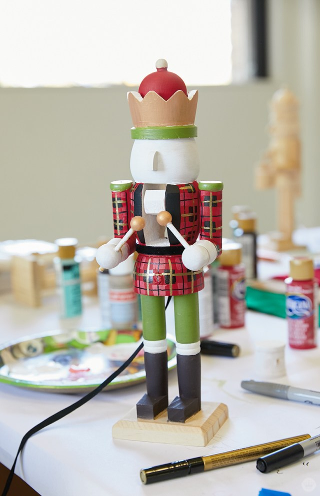 Hand painted wooden nutcracker waiting for finishing touches