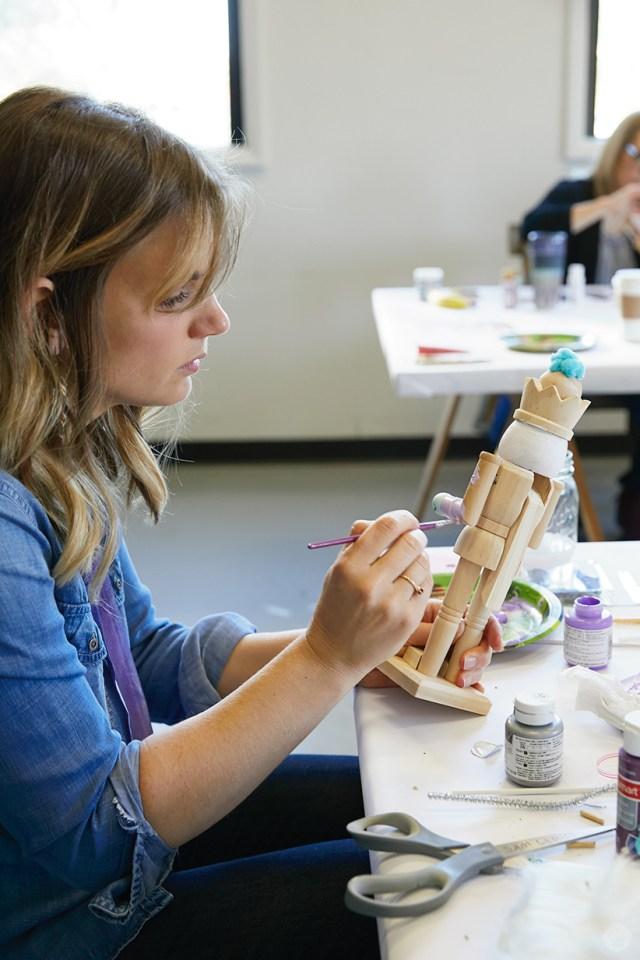 Hallmark Artist Sam L. paints a wooden nutcracker