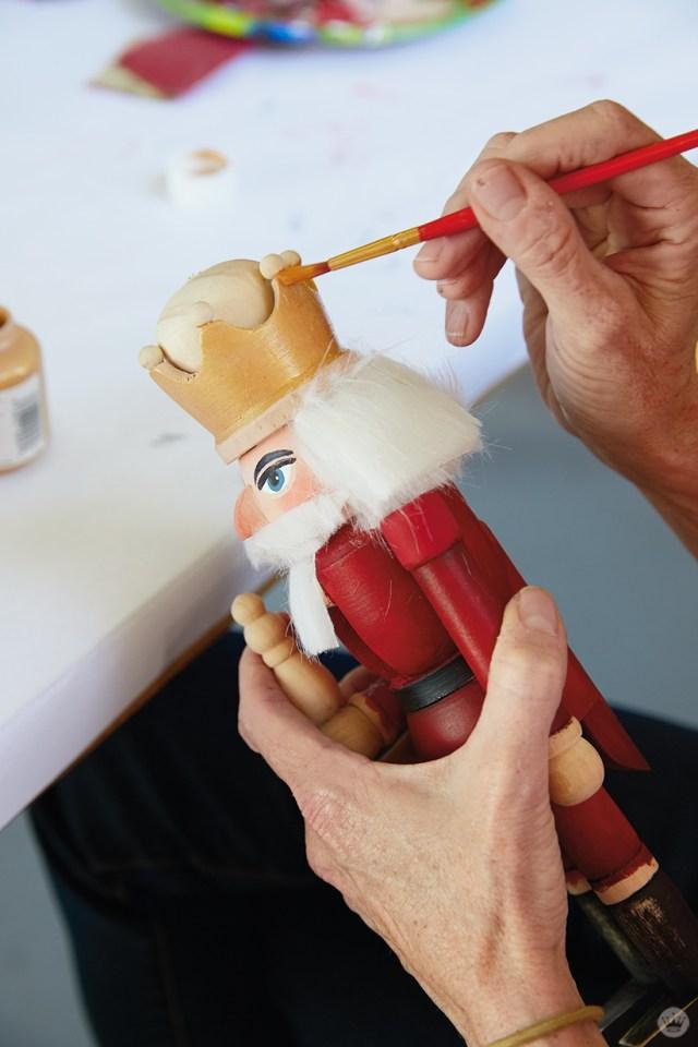 Hallmark artist in a paint your own nutcracker workshop