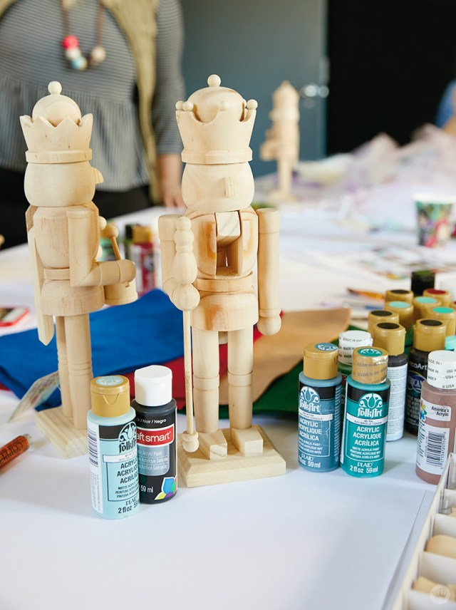 Unpainted wooden nutcrackers and painting supplies