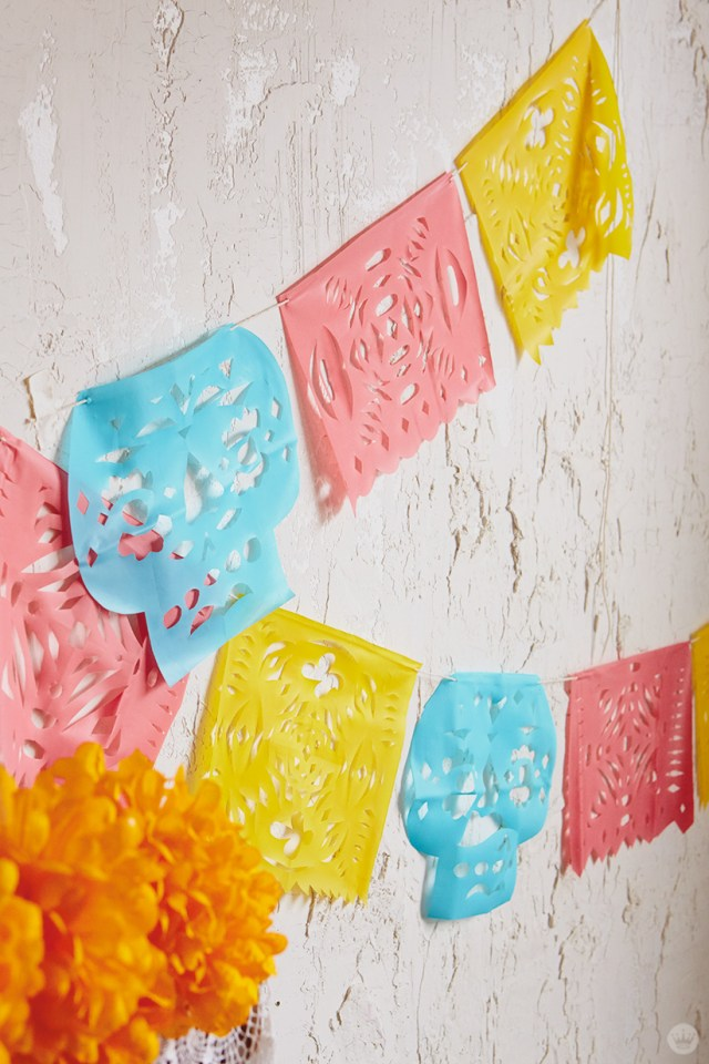 Papel Picado in pink, blue, and yellow