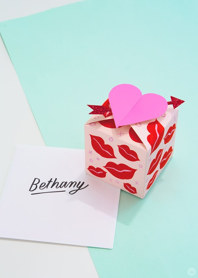 A Paper Wonder gift box decorated with painted lips and an arrow through the heart, with an envelope addressed to Bethany | thinkmakeshareblog.com