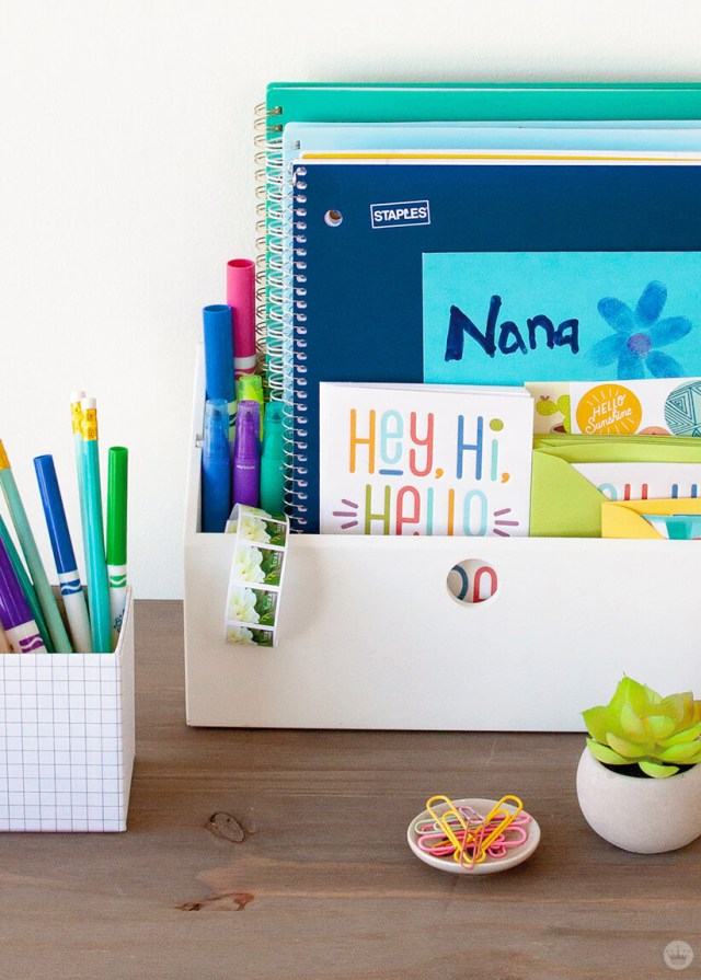 Teaching kids to write letters: Letter-writing station with pens, pencils, paper, stickers, and stamps. | thinkmakeshareblog.com