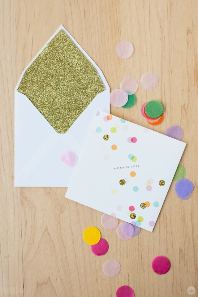 Envelope art: Glitter-covered envelope liner and paper confetti with matching card
