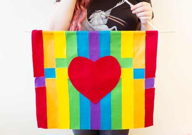 Rainbow-striped banner with heart for Pride Month.