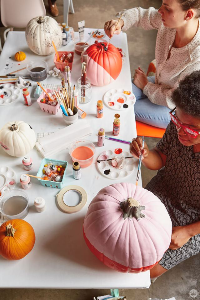 Hallmark artists painting pumpkins