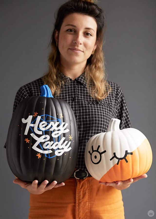 Artist displaying Hexy Lady and Winky Face pumpkins