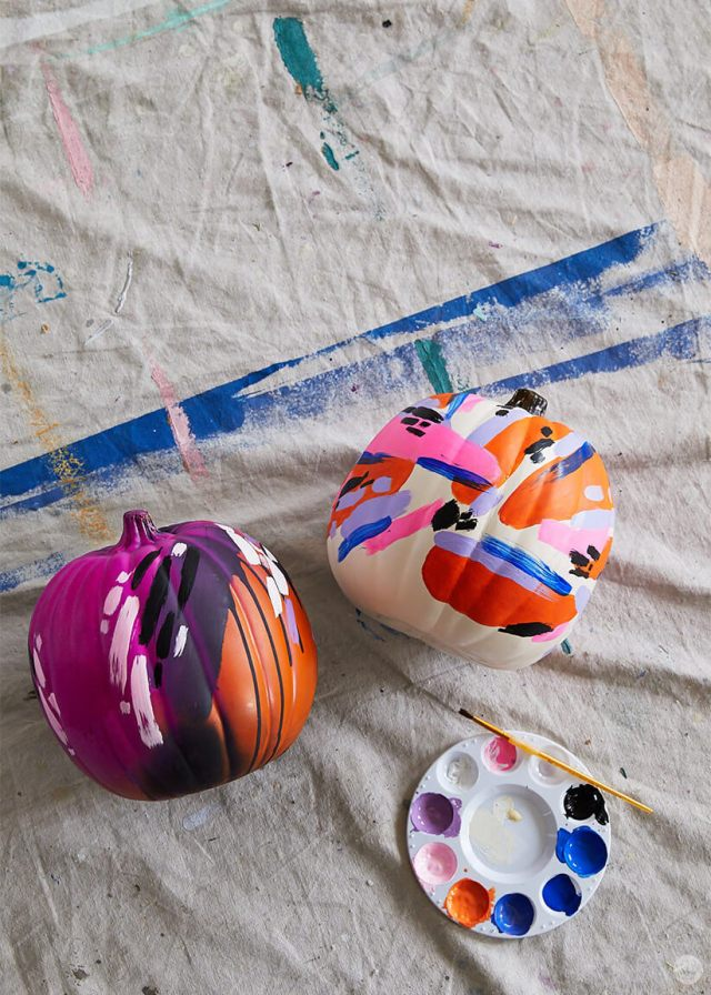 Pumpkins painted with abstract brush marks in different colors