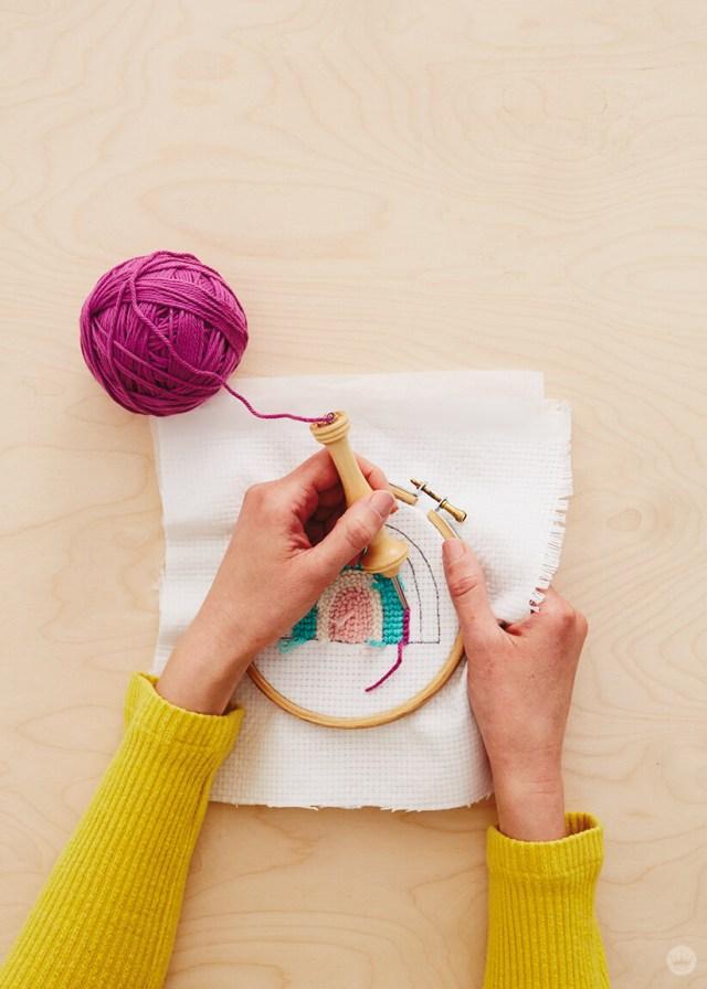 Needle punching a rainbow-ish design| thinkmakeshareblog.com