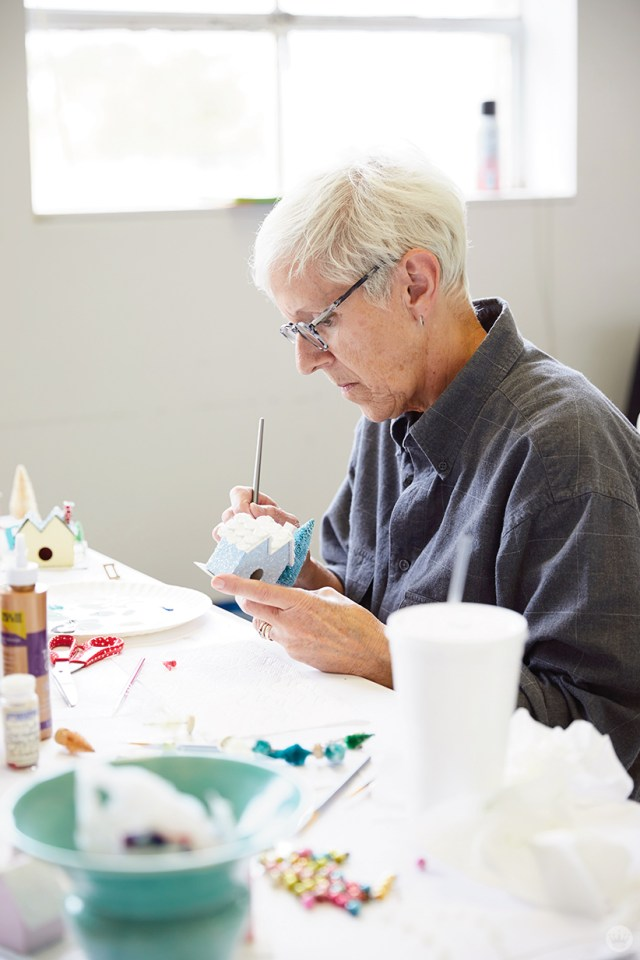 "Hallmark artist painting a glitter-covered ""putz house"""