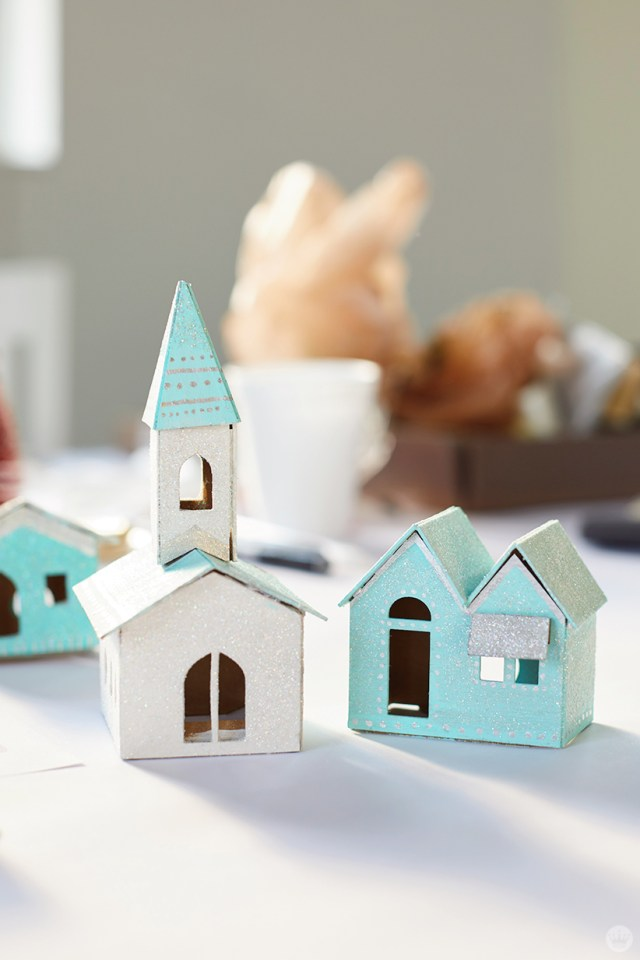Miniature glitter-covered church and house
