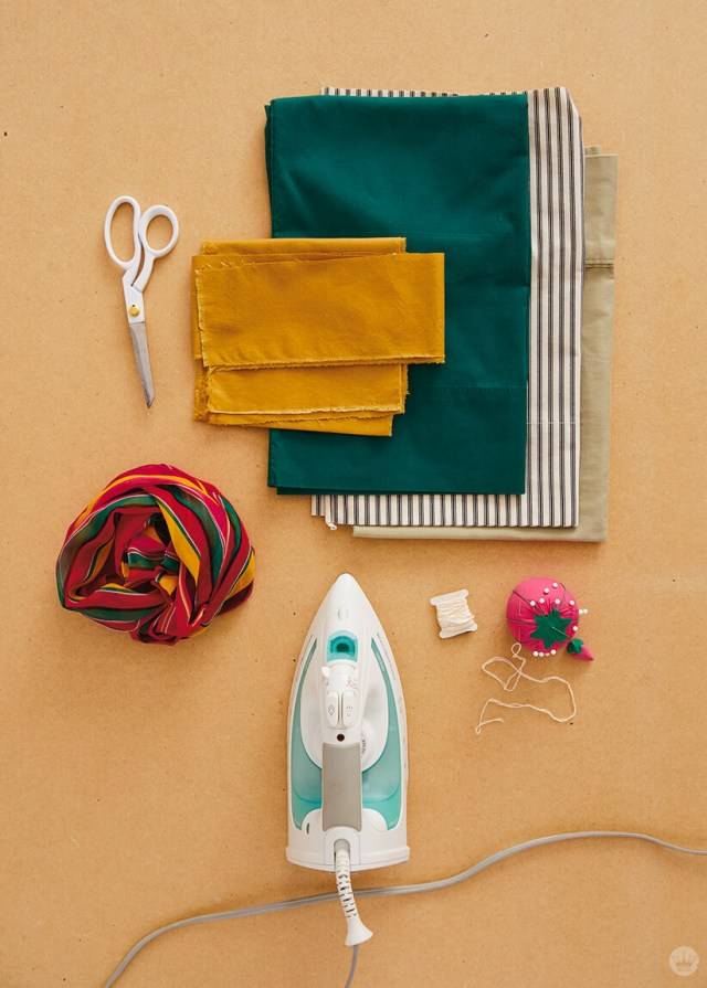 Supplies for the Reusable Tote Bag: pillowcases, fabric scraps, scarf, embroidery floss, pins and needles, scissors, iron | thinkmakeshareblog.com