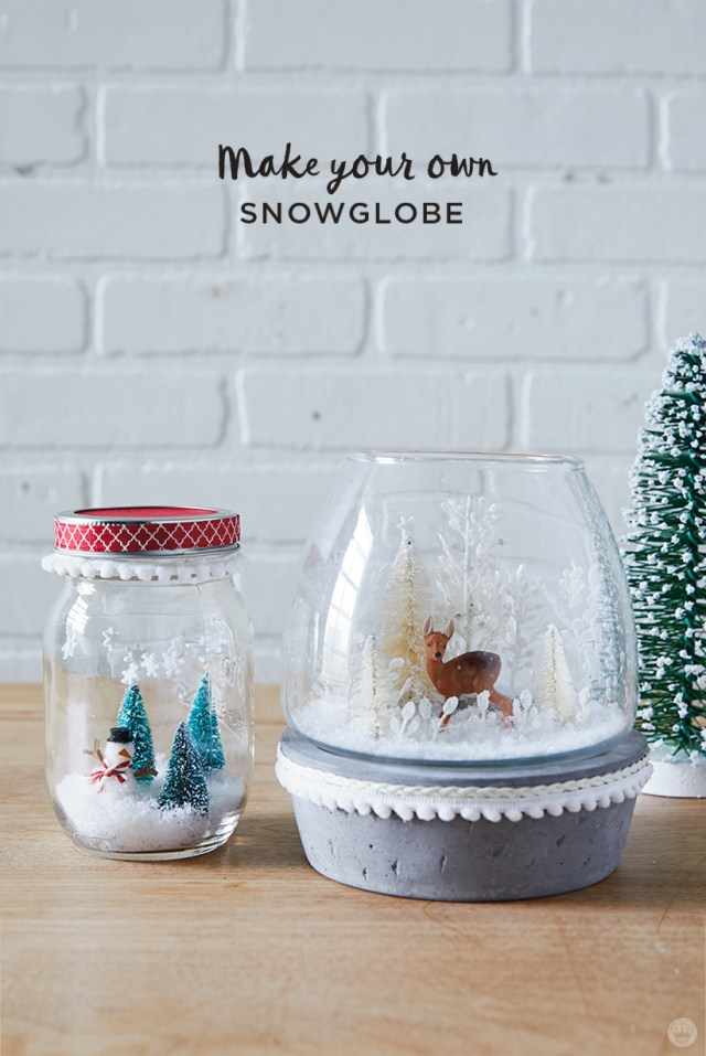 DIY Snow Globes with trees, a snowman, and a deer