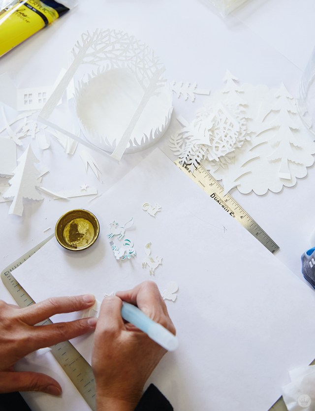 Cutting winter scenes from white card stock