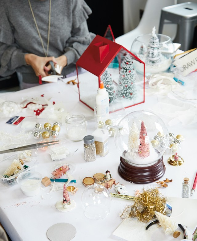 A table in Hallmark's DIY snow globe workshop