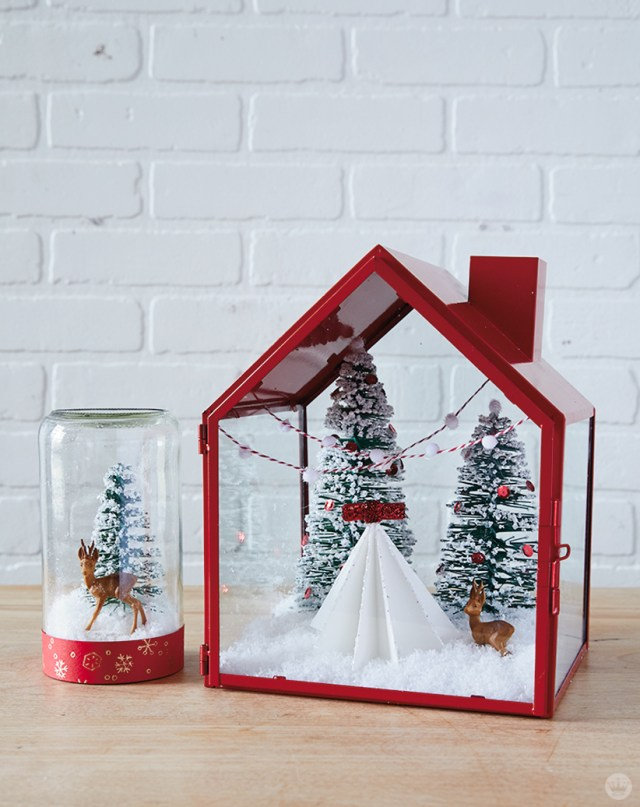 Simple snow globes with bottle brush trees and red accents